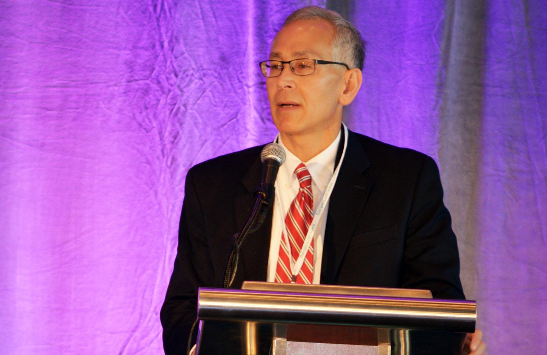 SARC semi-annual meeting 2016 man speaking at podium