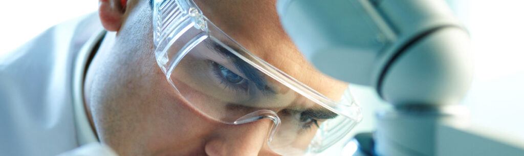 Researcher with safety glasses working